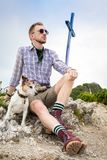 Dog and owner hiking a mountain top Stock Photography