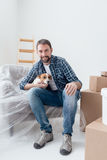Dog owner in his new house Stock Photos