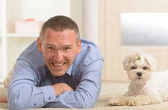 Dog and owner. Little dog maltese with his owner on the sofa in home Royalty Free Stock Photos