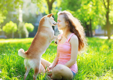 Dog and owner in park Stock Images