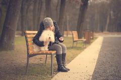 Dog with owner in the park Royalty Free Stock Images