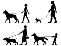 Dog owner variety. Editable vector silhouettes of contrasting dogs and owners Royalty Free Stock Photo
