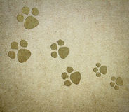 Dog paper background. Background with cute animal footprints Royalty Free Stock Image