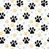 Dog paw print seamless pattern. On white background Stock Photo