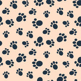 Dog paw print vector seamless pattern. Blue footprints on light pink background Stock Image