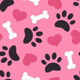Dog paw trace silhouette with bones and pink heart seamless pattern. Stock Photography
