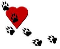 Dog Paw Tracks on Heart Royalty Free Stock Photo