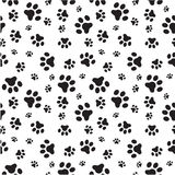 Dog paws seamless pattern. A random sized seamless pattern of dogs paws silhouettes royalty free illustration