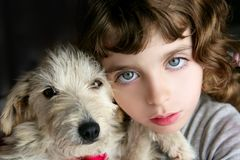 Dog pet and girl portrait blue eyes Stock Photo