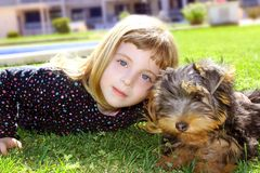 Dog pet and littl girl portrait on garden Royalty Free Stock Photography