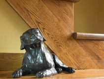 A dog. Photo taken of a statue of a dog installed at the bottom of a staircase royalty free stock images
