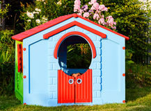 Dog playing hide and seek game at garden playground house Royalty Free Stock Photo