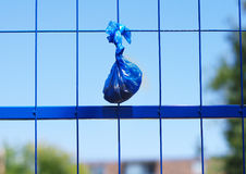 Dog poo bag hanging royalty free stock photography