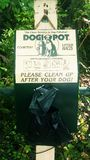 Dog potty bags. Dog potty bag on a wood post in a public park. Dog Park potty bag post royalty free stock images