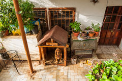 Dog protects the house. Booth and the dog near the entrance to the house Stock Images