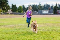 Dog racing girl Royalty Free Stock Photo