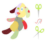 A dog ragdoll, scissors and needle Royalty Free Stock Images