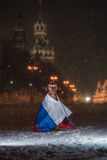 Dog Rhodesian Ridgeback and a Russian flag. On the background of a winter of Saint Basil's Cathedral at night, Red Square, Moscow, Russia Royalty Free Stock Image