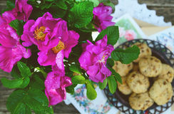Dog rose bunch and homemade cookie Royalty Free Stock Images