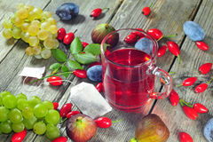 Dog rose tea and autumn fruits Royalty Free Stock Photo