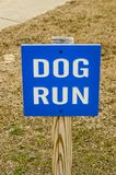 Dog Run Sign. Bright blue and white sign for a dog run stock photos