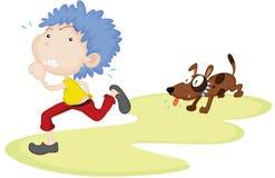 A Dog Running Behind a Boy Stock Photo