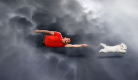 Canine education, dragged through the clouds royalty free stock photo