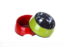 Dog's bowl. Two dog's bowls:green bowl and red bowl Stock Photography