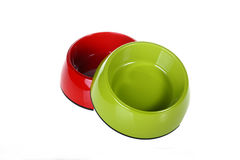 Dog's bowl. Two dog's bowls:green bowl and red bowl Stock Photos