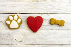 Dog`s paw, red heart and bone. A dog loves bones. Composition of the figures Royalty Free Stock Image