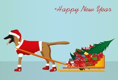 A dog in a Santa Claus hat carries a sleigh with gifts. A dog in a Santa Claus hat carries a sleigh with gifts and a Christmas tree for the Christmas holiday Stock Images