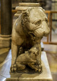 Dog sculpture at base of a column of the Pulpit, in the Siena Cathedral Stock Photography