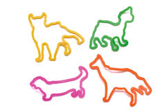 Dog shaped colorful rubber bands Stock Image