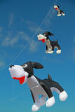 Dog shaped Kite flying in clear blue sky Stock Photo