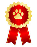 Dog show award ribbon. Dog competition winner gold award ribbon / stamp seal with red ribbon and paw print on center Royalty Free Stock Image