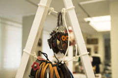 Dog show -Sale leather products. Decorations for cell phones in the form of an owl Stock Image