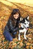 Dog siberian husky and young woman Royalty Free Stock Photos