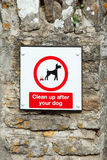 Dog Sign. Clean up after your dog sign royalty free stock photo