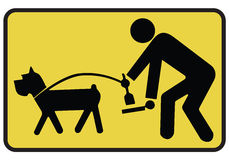 Dog Sign. Clean up after your dog sign hanging on white background Royalty Free Stock Photos