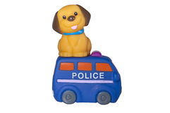 Dog sitting over police car, isolated on white Stock Photography
