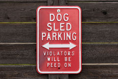 Dog sled parking – Violators will be peed on Royalty Free Stock Photography
