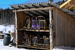 Dog sleds stacked in a small chalet royalty free stock image