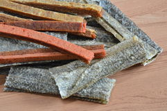 Dog snack crispy salmon skin and chicken soft stick. On table Royalty Free Stock Photography