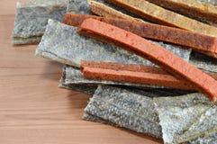 Dog snack crispy salmon skin and chicken soft stick Stock Photo
