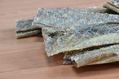 Dog snack crispy salmon skin Stock Photo