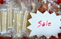 Dog snack in plastic bag packing on basket for sale in pet shop Royalty Free Stock Photos