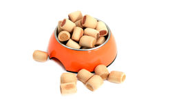 Dog snacks in bowl Stock Photography