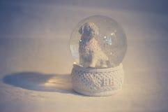 Dog snow-globe. Snowfall inside the golden retriever snowglobe Royalty Free Stock Photos