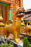 Dog statue in front of the church. The statue in front of the church at thailand Royalty Free Stock Photography