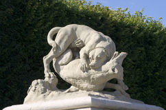 Dog statue in the park of sceaux Royalty Free Stock Image